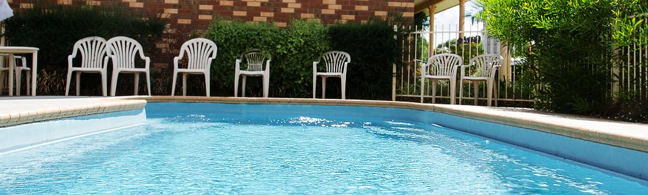 Relax by a salt water pool at Highway Inn Motel Hay